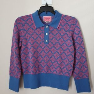 Floral spade polo sweater. Vibrant blue